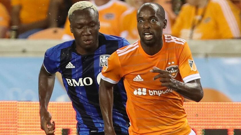 Houston Dynamo defender DaMarcus Beasley (7) looks up for a pass while Montreal Impact forward Ballo