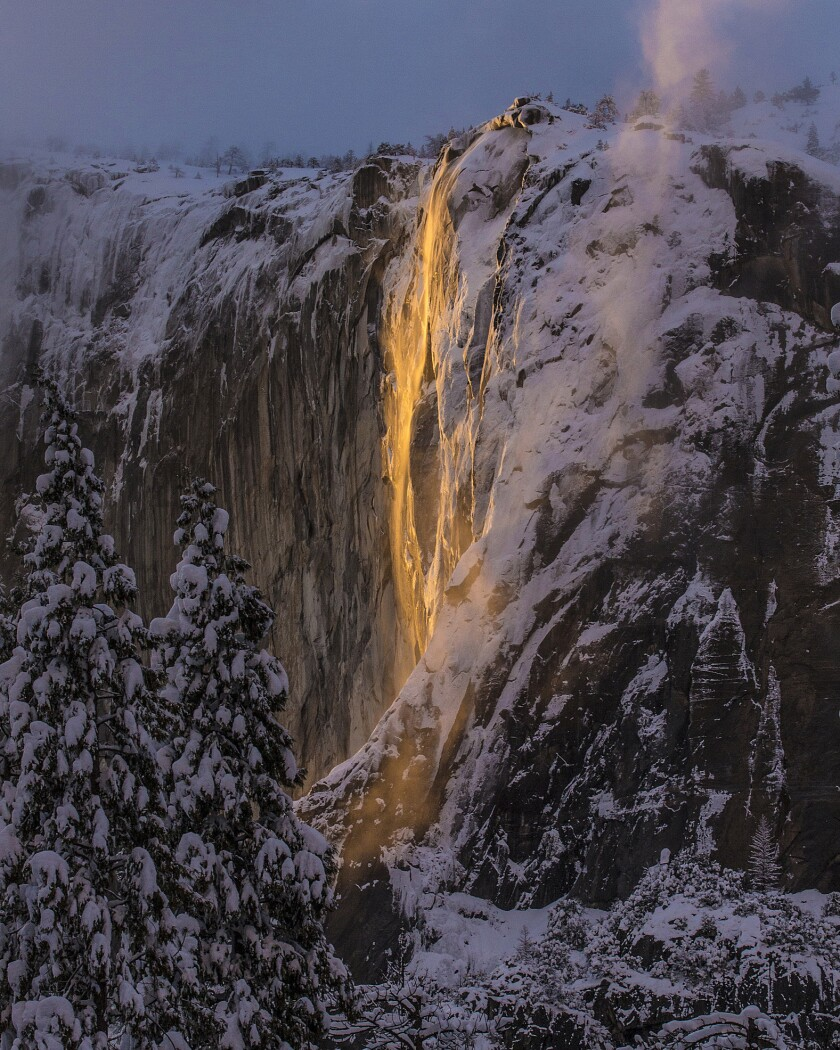 This Sunday, Feb. 17, 2019, photo released by Dakota Snider shows Horsetail Fall in Yosemite Nationa