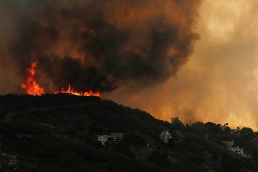 Flames leap over a canyon in Malibu in 2007.