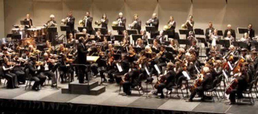 Steven Schick conducts the Symphony orchestra. Bill Dean