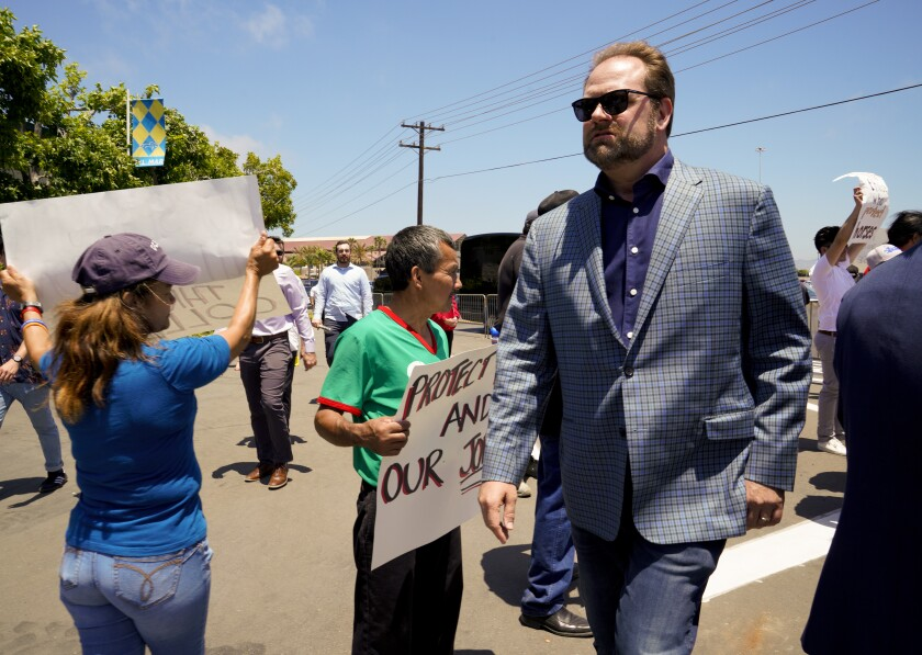 Protesters and counter-protesters at Del Mar's opening day Wednesday included Doug O'Neill, the veteran trainer who guided 2016 Kentucky Derby winner Nyquist.