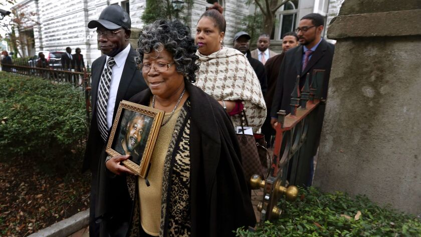 The parents of Walter Scott, Walter Scott Sr. and Judy Scott, leave the courthouse after former Nort