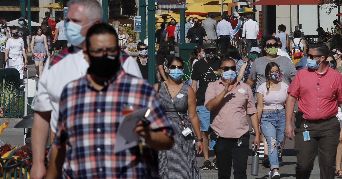 Downtown Disney reopens as coronavirus rages in Orange County - Los Angeles Times