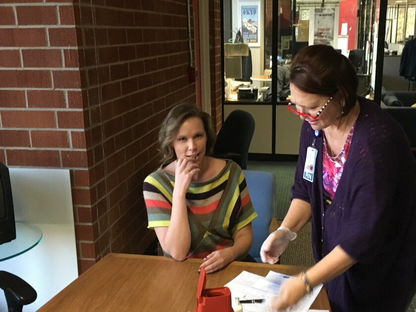 U-T reporter Jennifer Van Grove receives a free flu shot from an Envision nurse who was dispatched through the Pager app.
