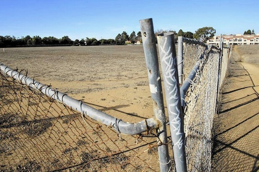 A decision on the fate of a five-acre parcel known as the Ridge at the southeast corner of Bolsa Chica Street and Los Patos Avenue has been postponed.