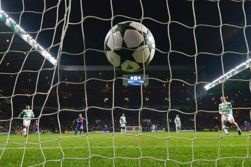 The ball slams into the back of the net after Barcelona's Argentinian striker Lionel Messi (unseen) scored a penalty for Barcelona's second goal during the UEFA Champions League group C football match between Celtic and Barcelona at Celtic Park in Glasgow on November 23, 2016. / AFP PHOTO / Paul ELLISPAUL ELLIS/AFP/Getty Images ** OUTS - ELSENT, FPG, CM - OUTS * NM, PH, VA if sourced by CT, LA or MoD **