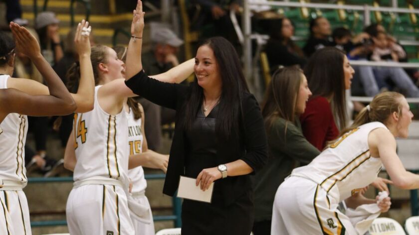 Head coach Lisa Faulkner leads a boisterous group of players at Pt. Loma Nazarene.