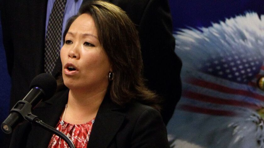 Anna Park, regional attorney at the U.S. Equal Employment Opportunity Commission, speaks at a news conference in 2011. On Wednesday, Park announced a $3.5-million settlement with Irvine customer service firm Alorica Inc.
