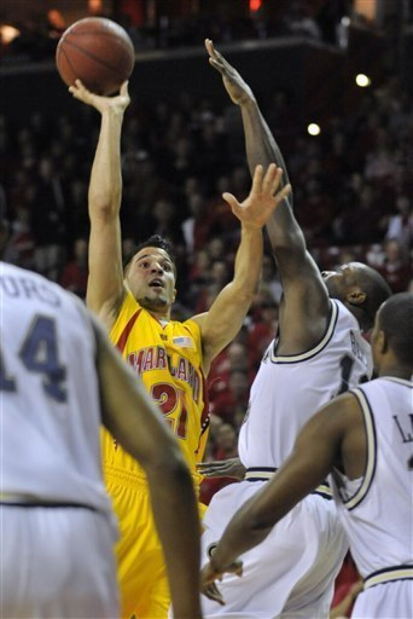 Maryland's Greivis Vasquez shoots as Georgia Tech's Derrick Favors defends in the first half of an NCAA college basketball game Saturday, Feb. 20, 2010 in College Park, Md.(AP Photo/Gail Burton)