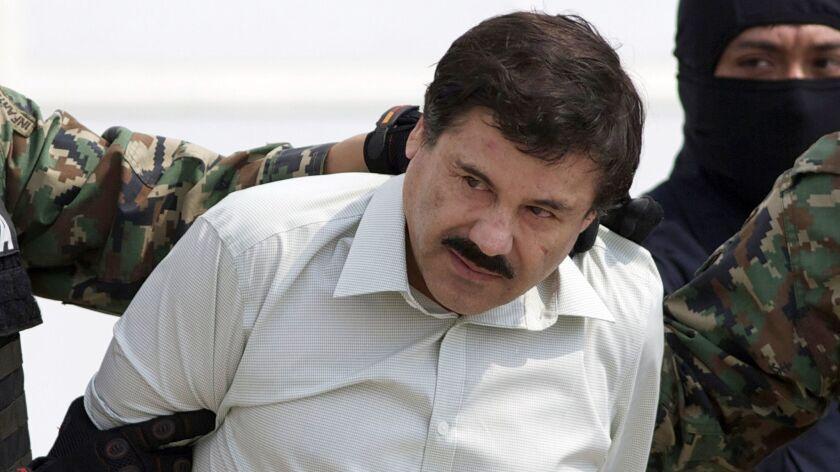 "Joaquin ""El Chapo"" Guzman, head of Mexico's Sinaloa cartel, is escorted to a helicopter in Mexico City on Feb. 22, 2014, following his capture in Mazatlan."