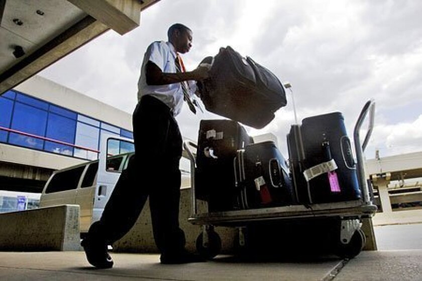 United Airlines and US Airways will raise luggage fees by $5 per bag for customers who pay at the airport. (AP file photo)