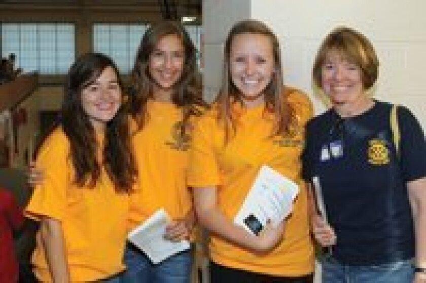 Student volunteers Bridget Eastwood, Brooke Billmeyer, Cat Pierce, Rotarian Glenda Collins
