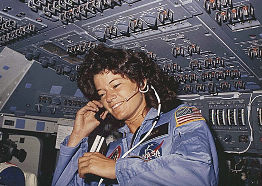 A June 1983 photo shows America's first woman astronaut Sally Ride, as she communicates with ground controllers.