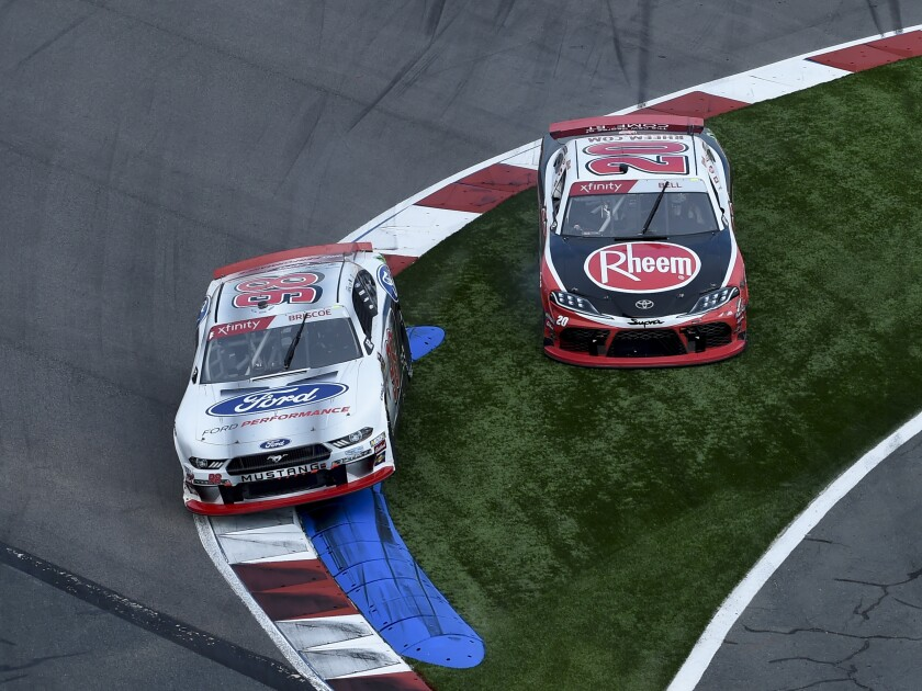 Chase Briscoe, (98) and Christopher Bell, (20) run off the course in Turn 17, resulting in a penalty for Bell, during a NASCAR Xfinity Series auto race at Charlotte Motor Speedway, Saturday, Sept. 28, 2019, in Concord, N.C. (AP Photo/Mike McCarn)