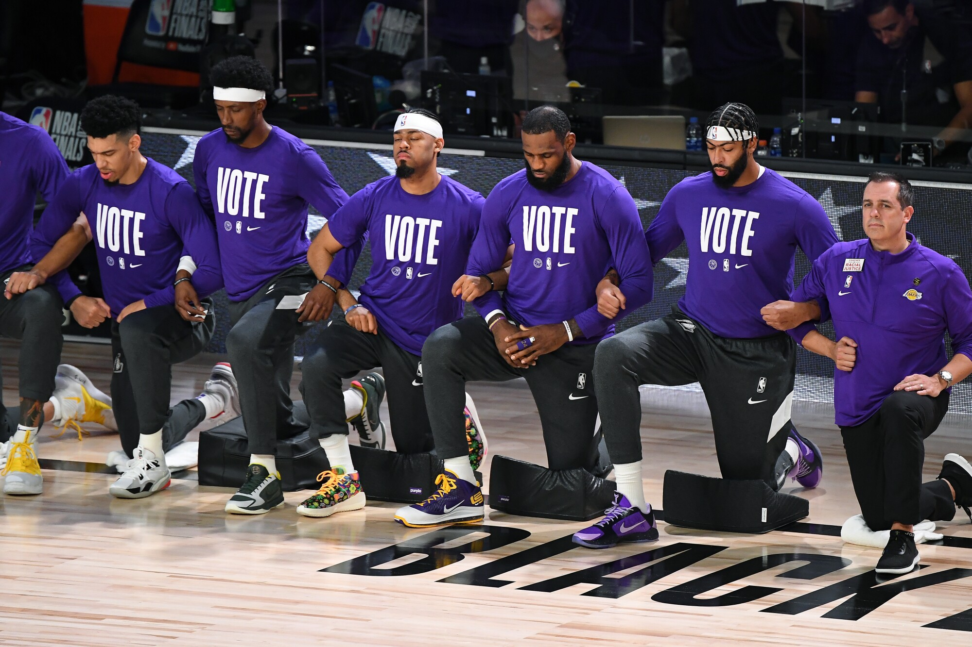 ORLANDO, FLORIDA SEPTEMBER 30, 2020-Lakers players kneel during the National Anthem before Game 1.