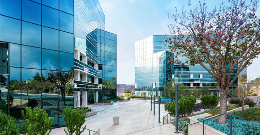 Sorrento Towers is a two, seven-story office complex that sits above a three-level parking garage.