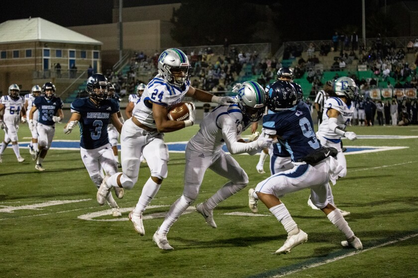 Eastlake running back Estabond Moss runs the ball during the second half of Friday night's game against Otay Ranch.