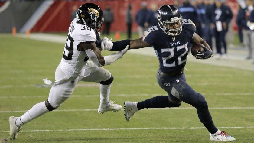 Tennessee Titans running back Derrick Henry (22) runs against Jacksonville Jaguars free safety Tasha