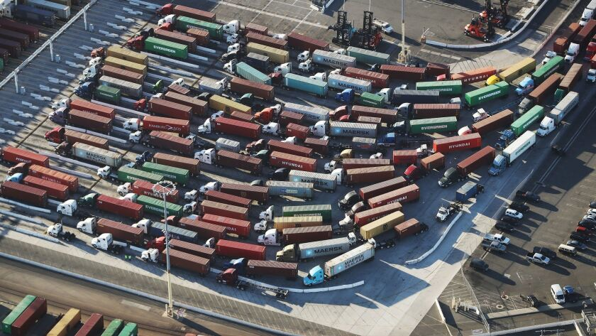 Trucks with shipping containers at the Port of Los Angeles on Sept. 18.