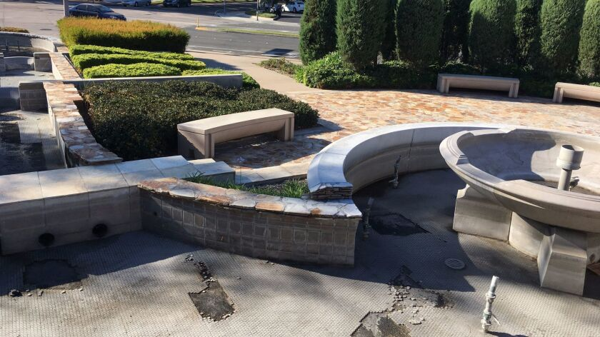 The dry fountain in a view looking toward Slater Avenue.