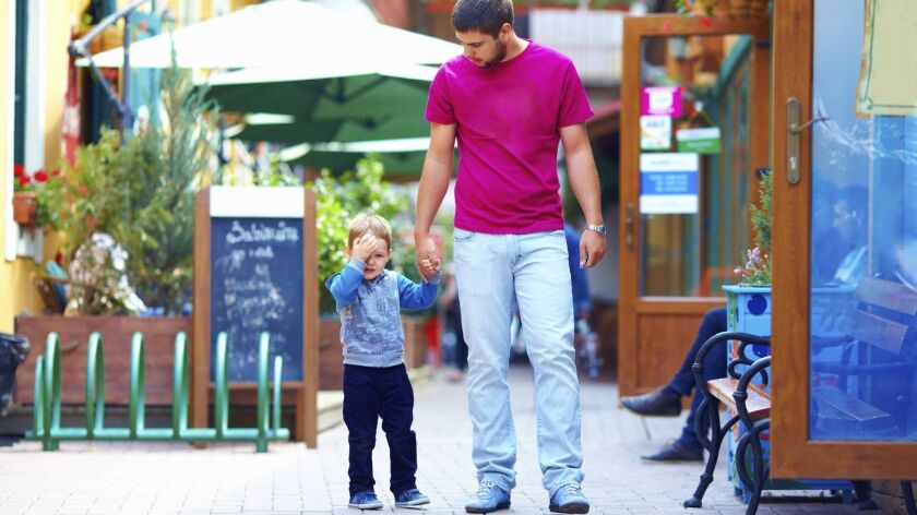 upset baby and father on the city street_User Upload Caption: Tips for parents when kids have temper