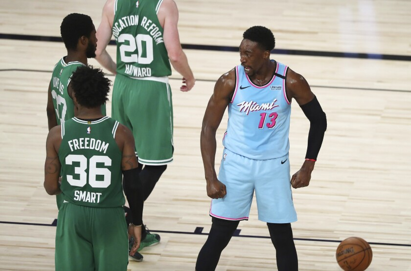 Miami Heat forward Bam Adebayo (13) reacts after scoring and getting fouled against the Boston Celtics during the second half of an NBA basketball game Tuesday, Aug. 4, 2020, in Lake Buena Vista, Fla. (Kim Klement/Pool Photo via AP)