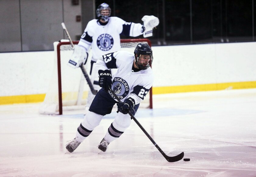 """In this photo taken Nov. 8, 2014, and provided by Keith Walters, Geneseo's Matthew Hutchinson skates with the puck during an NCAA college hockey game against SUNY Plattsburgh in Geneseo, N.Y. When the Geneseo State Knights arrive in Lake Placid to prepare for their second Division III Frozen Four in three years, they'll keep an empty stall in the locker room at Herb Brooks Arena in memory of the guy they call """"Hutch."""" Hutchinson, a former defenseman, was found dead inside a Geneseo home in January, a victim in a violent attack that also took the life of senior Kelsey Annese, a guard on the Geneseo women's basketball team. (Keith Walters via AP)"""