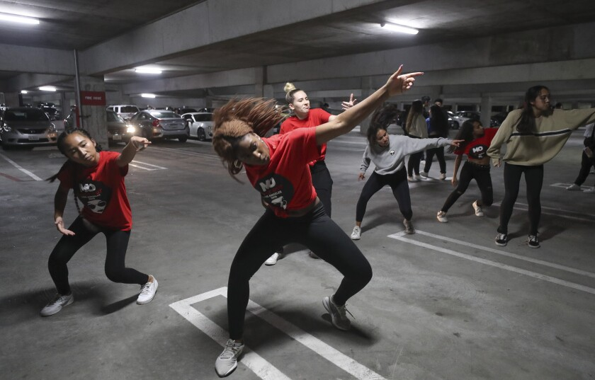 San Diego State student Maria Sulaiman, 19, front, leads her group as they practice their hip-hop dance that she choreographed before performing in the end of the year choreography project put on by the SDSU Vietnamese Student Organization Modern, a collegiate hip-hop dance troupe, in a parking garage on the SDSU campus on Thursday, December 5, 2019 in San Diego, California.