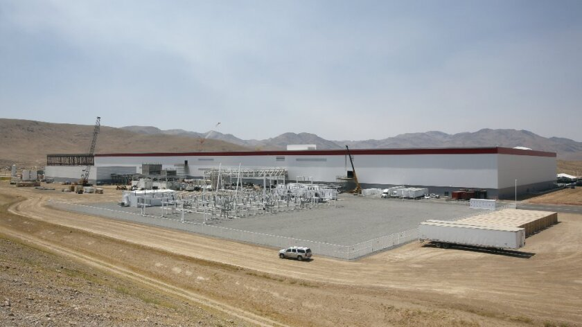 The $5-billion Tesla Gigafactory in Sparks, Nev., began the mass production of lithium-ion battery cells on Wednesday.