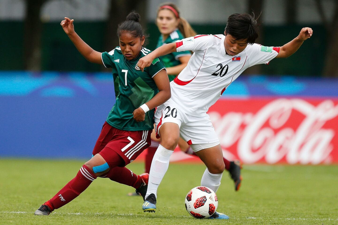 Mexico's Belen Cruz vies for the ball with Korea's Kum Ok Choe during the Women's World Cup U20 Group B football match between North Korea and Mexico at the Clos Gastel stadium in Dinan, northwestern France, on August 8, 2018. (Photo by CHARLY TRIBALLEAU / AFP)CHARLY TRIBALLEAU/AFP/Getty Images ** OUTS - ELSENT, FPG, CM - OUTS * NM, PH, VA if sourced by CT, LA or MoD **