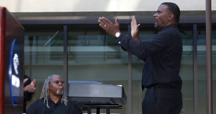 Kenneth Anderson (standing), a lecturer in the music department at UC San Diego, was picked No. 3 by the website RateMyProfessors.com. / photo by Kevin Walsh