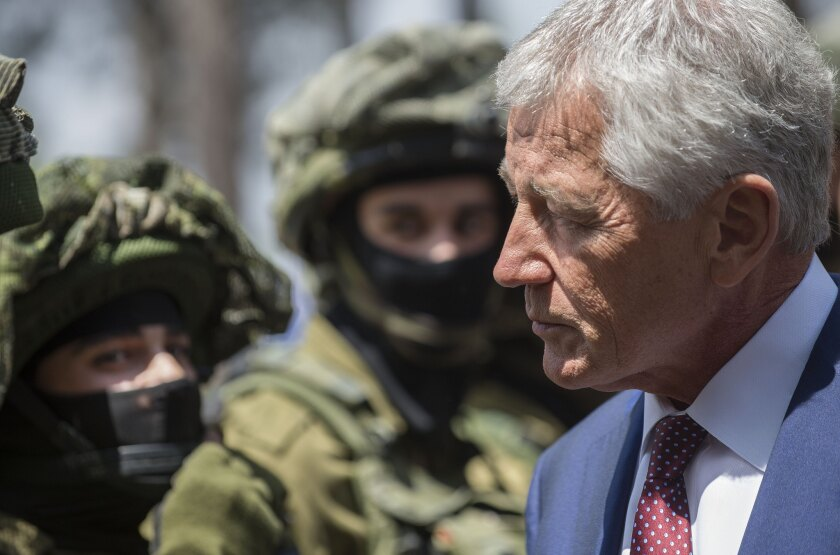 Secretary of Defense Chuck Hagel speaks with Israeli soldiers during a visit to a military canine unit training site at a base near Tel Aviv.