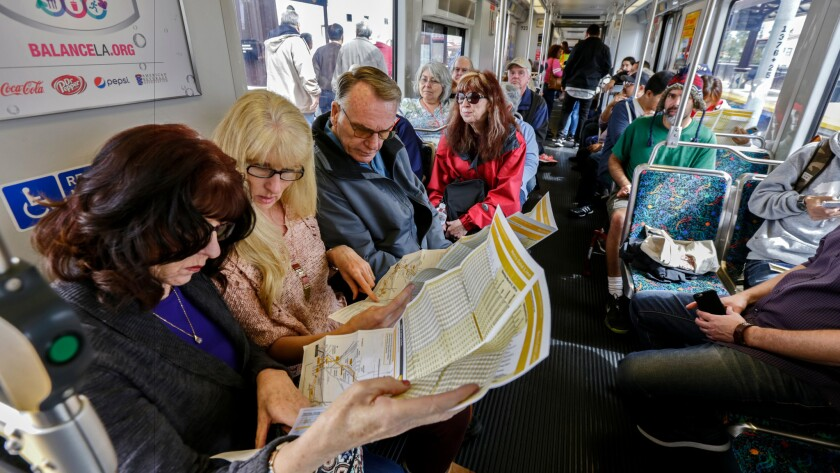 Passengers ride the Metro Gold Line train from APU/Citrus station to Los Angeles Union station on March 5.
