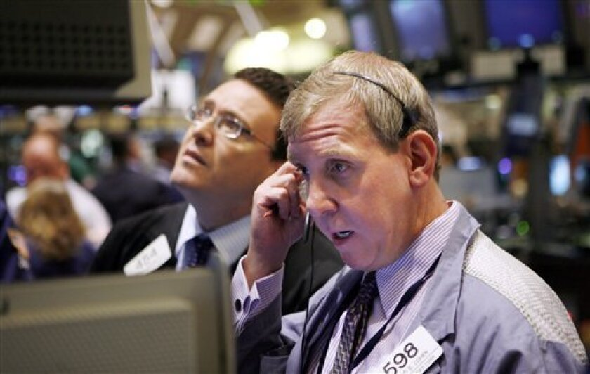 Traders and specialists work the trading floor of the New York Stock Exchange Wednesday, Sept. 1, 2010. in New York. (AP Photo/David Karp)