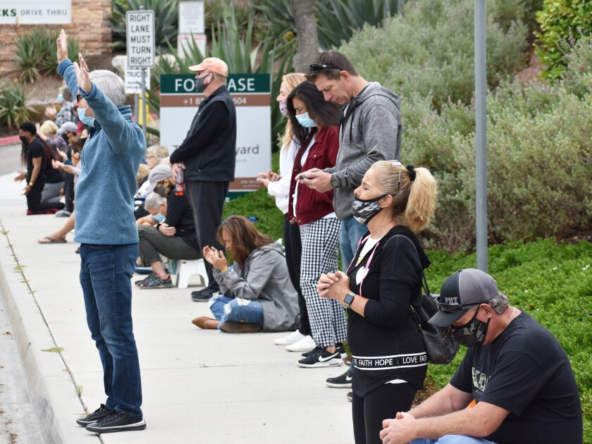 """Participants praying in Carmel Mountain Ranch during the """"We Pray San Diego"""" event in June."""