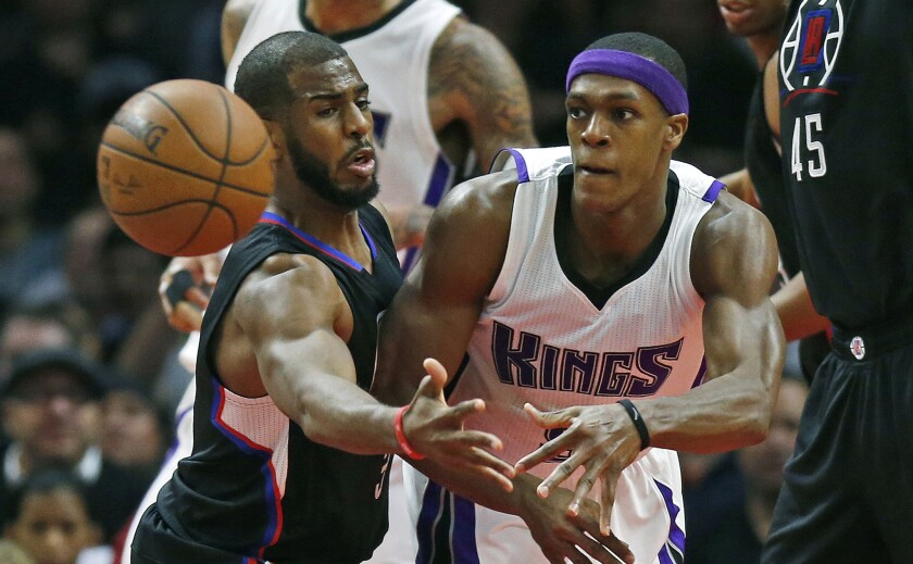 Clippers guard Chris Paul forces Kings guard Rajon Rondo to pass during the first half of a game at Staples Center on Jan. 16.
