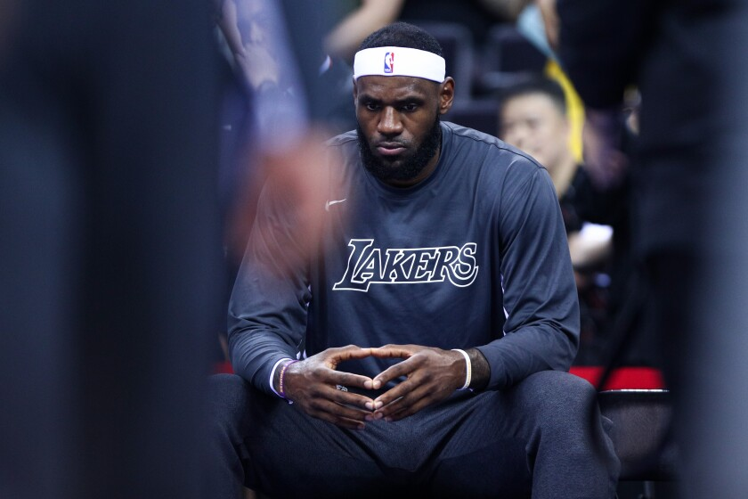 LeBron James concentrates before the Lakers play the Brooklyn Nets in a preseason game on Saturday in Shenzhen, China.
