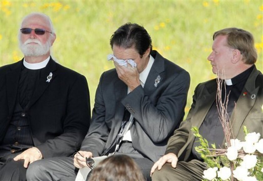 Wally Miller, Somerset County Coroner, weeps on stage before delivering a litany at the Flight 93 National Memorial Serivce near the crash site of Flight 93 in Shanksville, Pa. Sunday Sept. 11, 2011. (AP Photo/Gene J. Puskar)