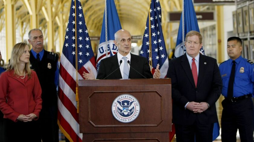 Kathy Kraninger, left, is President Trump's nominee to be director of the Consumer Financial Protection Bureau. She's shown here at a 2008 event when serving as deputy assistant secretary for policy at the Department of Homeland Security,