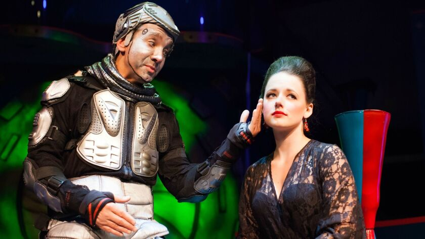 """Jason Graae as the sentient robot Ariel comforts Kimberly Hessler's lovelorn Miranda in the musical sci-fi spoof """"Return to the Forbidden Planet."""""""