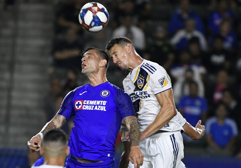 Galaxy's Daniel Steres battles Cruz Azul's Milton Caraglio on Aug. 20 at Dignity Health Sports Park.