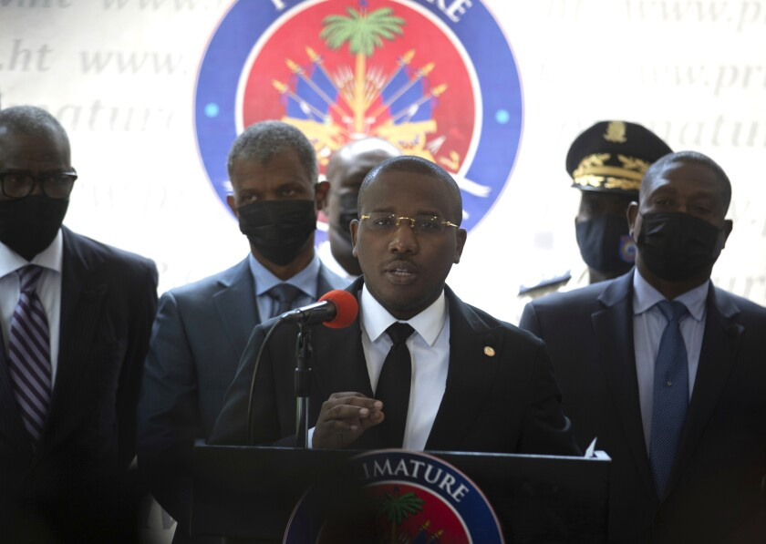 Haiti's interim Prime Minister Claude Joseph gives a press conference in Port-au-Prince, Friday