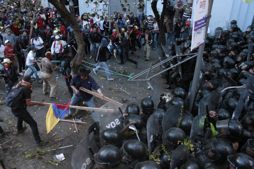 Protesters clash with police near the government palace in Quito, Ecuador, last week. A strike by a broad coalition upset with the policies of President Rafael Correa largely paralyzed the capital, provincial cities and stretches of the Panamerican highway.