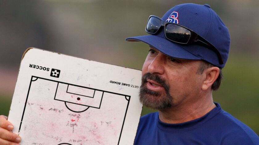 Steele Canyon girls soccer coach Charlie Cleaves urges on his players.
