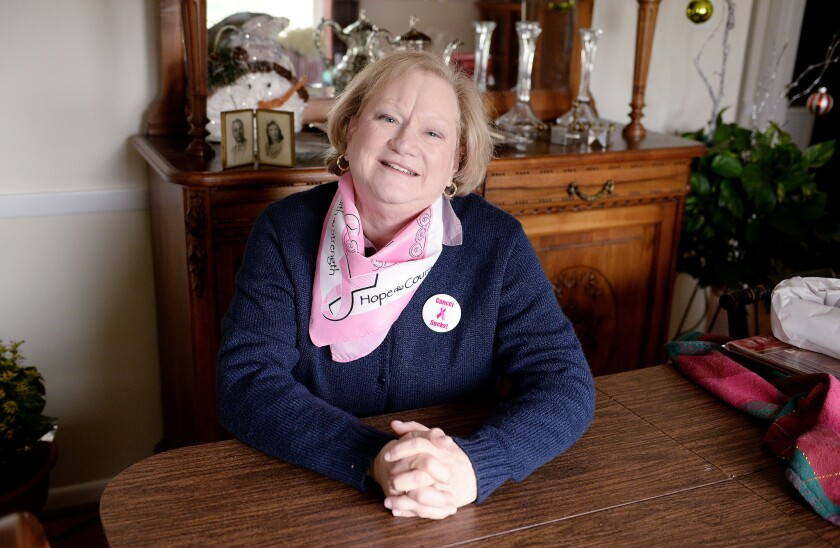 Cancer Survivor Lisa Gray poses in her house- DC