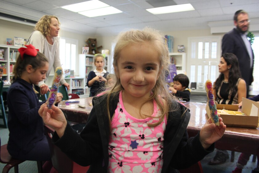 Rancho Santa Fe Children's Library guest Audrey makes a candle at last year's candlemaking event.