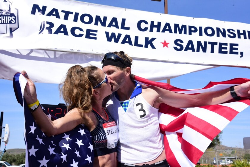 Robyn Stevens and Nick Christie, national race walk championship winners, share a buss at the end of the Santee competition.