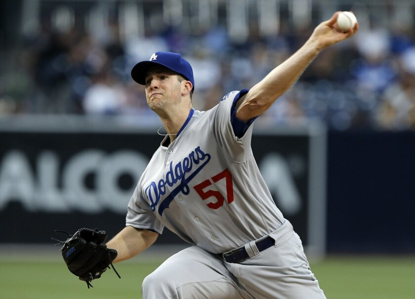 FILE - In this May 21, 2016, file photo, Los Angeles Dodgers starting pitcher Alex Wood throws against the San Diego Padres during the first inning of a baseball game in San Diego. Wood is set to undergo arthroscopic surgery on his left elbow that will keep him out for about eight weeks. The team a