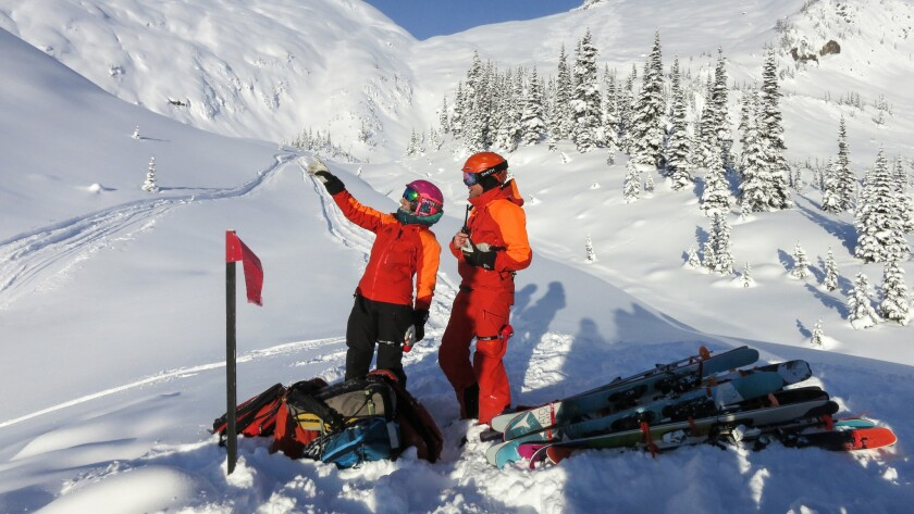 Guides JF Lacombe and Erika Flavelle plot out a route for our next run in Cariboo Mountains.