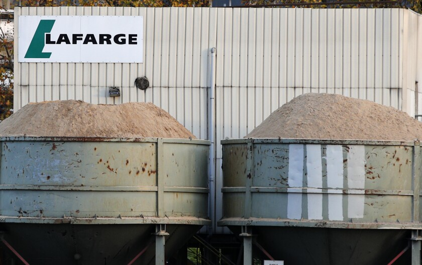 """FILE - In this Nov.14, 2017 file photo, a site of cement maker Lafarge is pictured in Paris. A French court Thursday Nov. 7, 2019 has quashed the charges of """"complicity in crimes against humanity"""" pressed against French cement company Lafarge yet said the judicial proceedings over Syria funding deals can continue. (AP Photo/Christophe Ena, File)"""